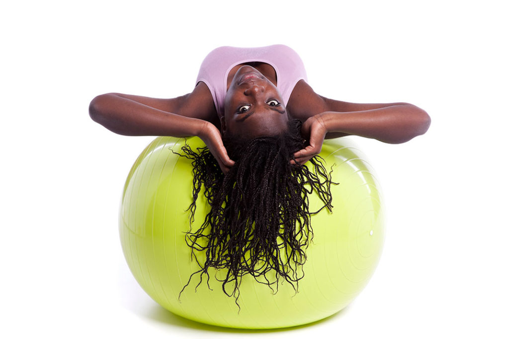 lateral back stretching  on a gymnastic ball