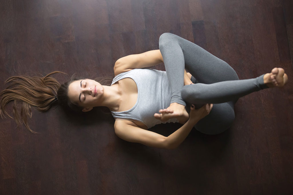 woman stretching her Gluteus