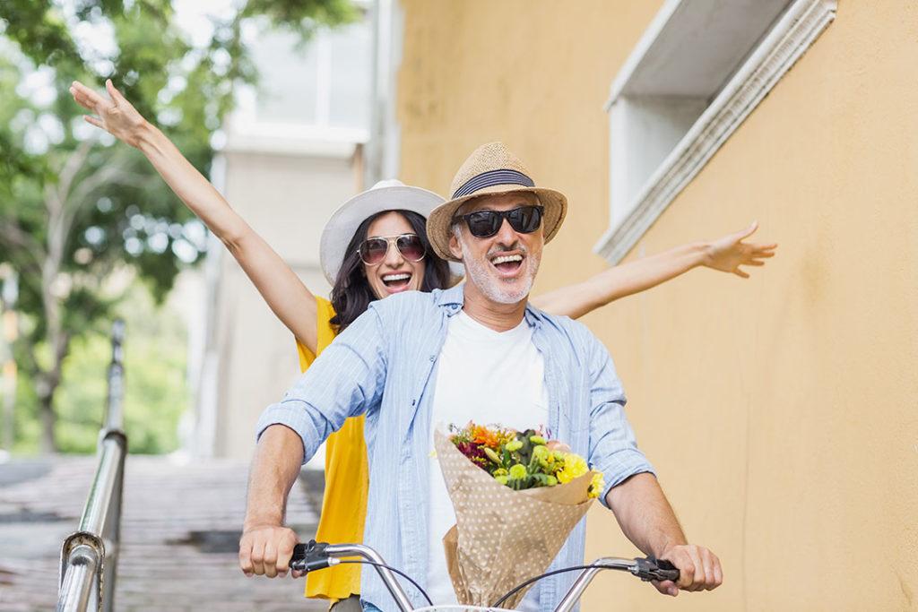 Couple on Bicycle having fun