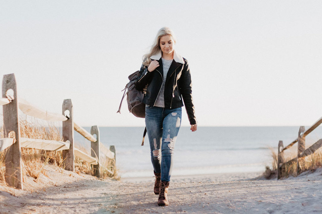 woman walking on the beach and thinking about get older